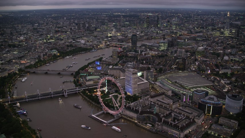 6K stock footage aerial video of approaching London Eye by the River Thames, London, England, night Aerial Stock Footage | AX116_144