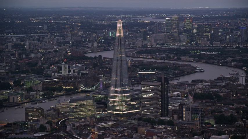 6K stock footage aerial video of a view of The Shard skyscraper and River Thames, London, England, night Aerial Stock Footage | AX116_145