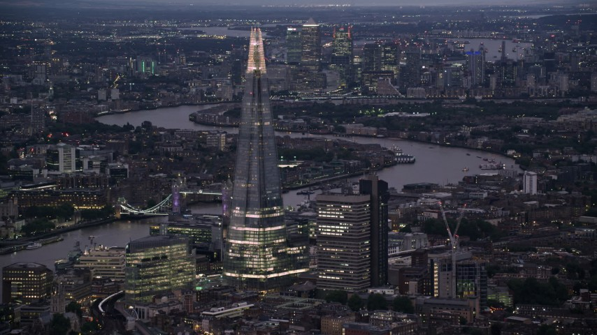 6K stock footage aerial video of flying by The Shard skyscraper by River Thames, London, England, night Aerial Stock Footage | AX116_146