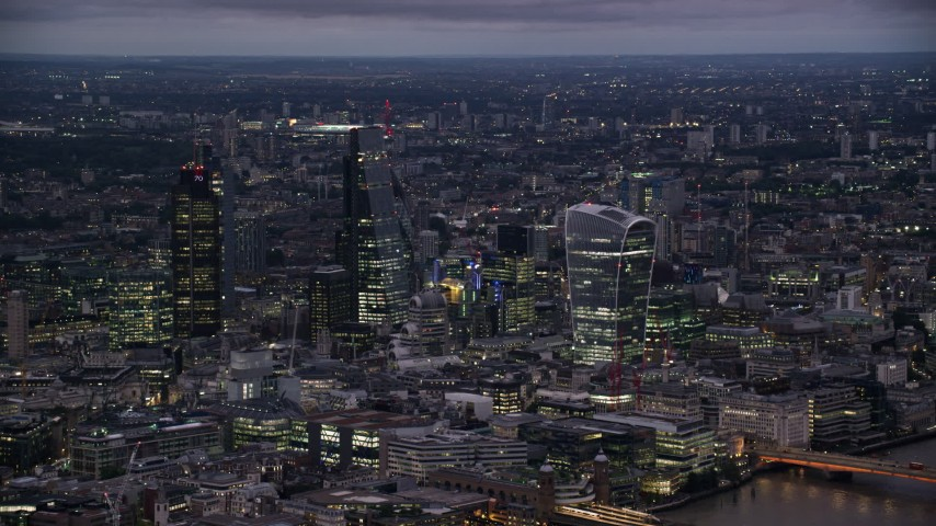 6K stock footage aerial video of flying by skyscrapers in Central London, London, England, night Aerial Stock Footage | AX116_147