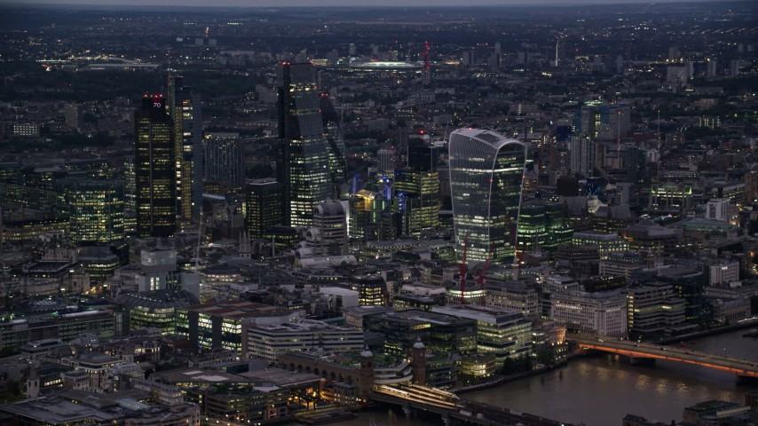 6K stock footage aerial video of passing by Central London Skyscrapers, London, England, night Aerial Stock Footage | AX116_148