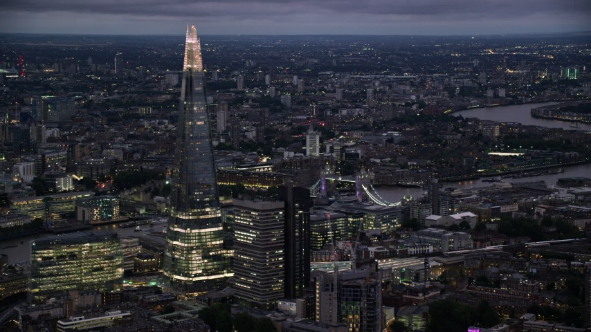 6K stock footage aerial video of The Shard skyscraper near the Tower Bridge, London, England, night Aerial Stock Footage | AX116_150