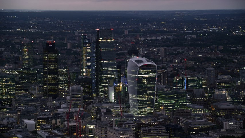 6K stock footage aerial video of tall skyscrapers in Central London, England, night Aerial Stock Footage | AX116_151