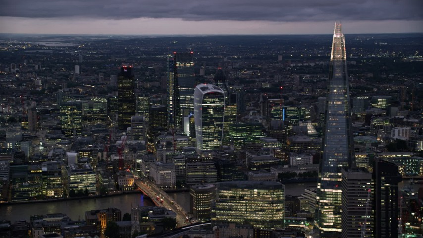 6K stock footage aerial video of flying by The Shard and Central London skyscrapers, London, England, night Aerial Stock Footage | AX116_152