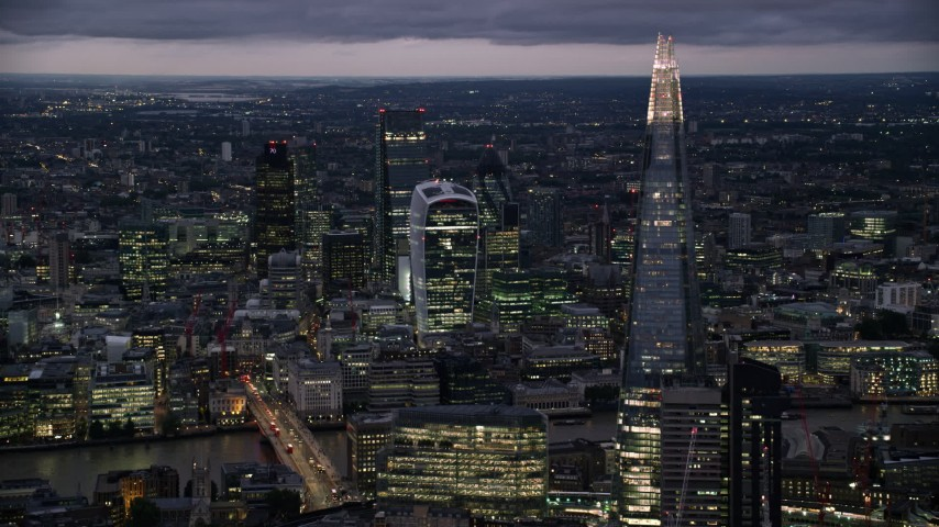 6K stock footage aerial video of flying by The Shard, Central London skyscrapers across River Thames, England, night Aerial Stock Footage | AX116_153