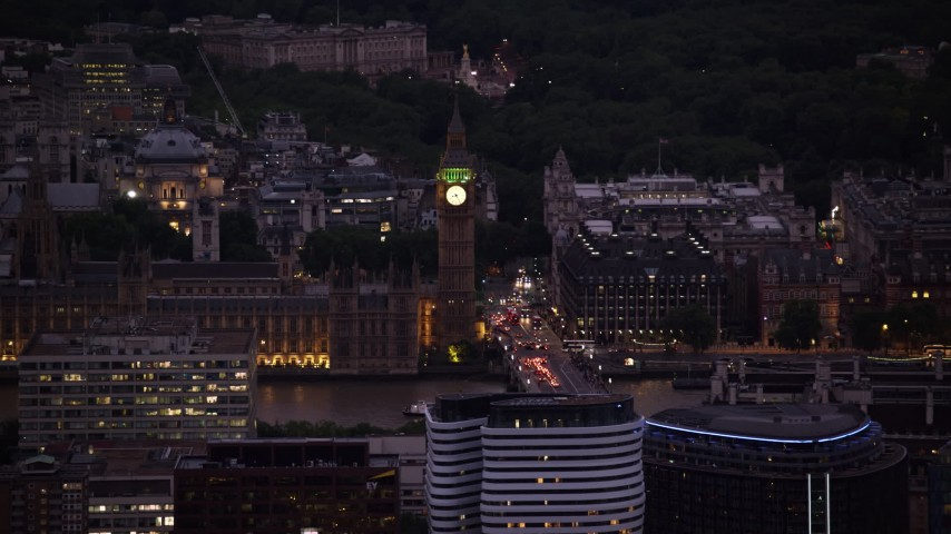 6K stock footage aerial video of flying by famous Big Ben and British Parliament, London, England, night Aerial Stock Footage | AX116_154