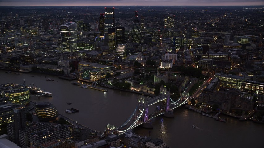 6K stock footage aerial video orbiting Tower Bridge and River Thames near Tower of London, England, night Aerial Stock Footage | AX116_157