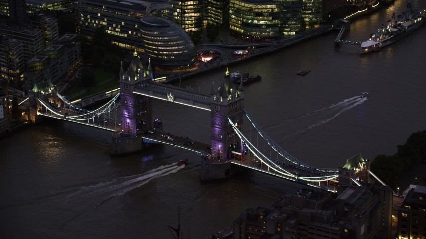6K stock footage aerial video of flying by Tower Bridge spanning River Thames in London, England, night Aerial Stock Footage | AX116_160