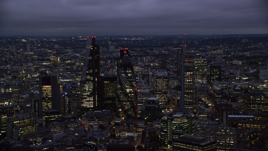 6K stock footage aerial video flyby Leadenhall Building, The Gherkin, Heron Tower in London, England, night Aerial Stock Footage | AX116_161