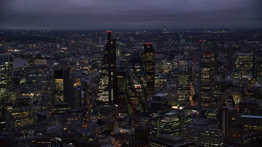6K stock footage aerial video of Leadenhall Building, Gherkin, Tower 42, Heron Tower skyscrapers, London, England, night Aerial Stock Footage | AX116_162