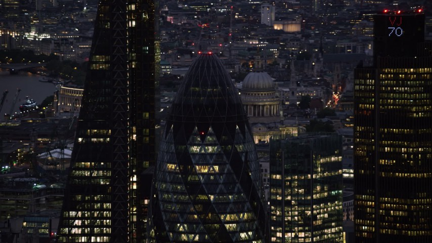6K stock footage aerial video of orbiting the top of The Gherkin skyscraper in London, England, night Aerial Stock Footage | AX116_163