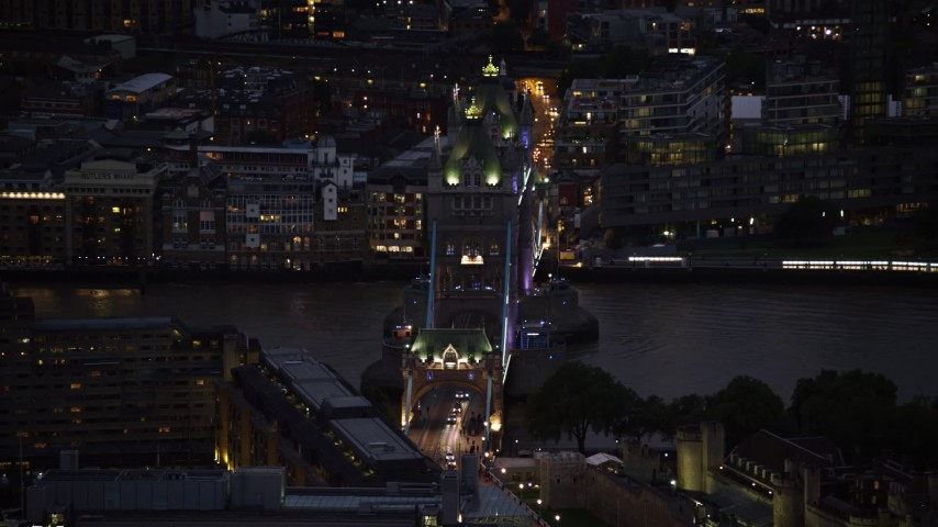 6K stock footage aerial video of slowly flying by Tower Bridge and River Thames, London, England, night Aerial Stock Footage | AX116_165