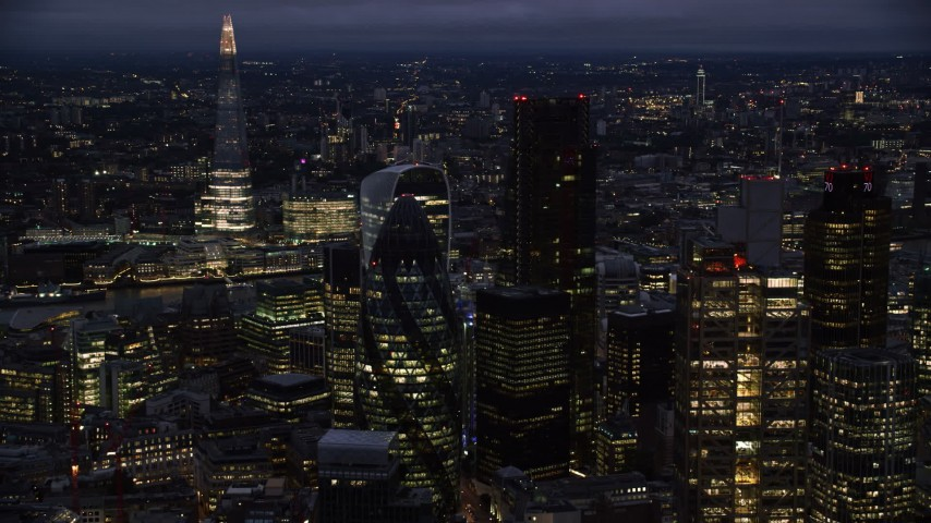 6K stock footage aerial video of The Gherkin seen from Heron Tower, The Shard in background, London, England, night Aerial Stock Footage | AX116_167