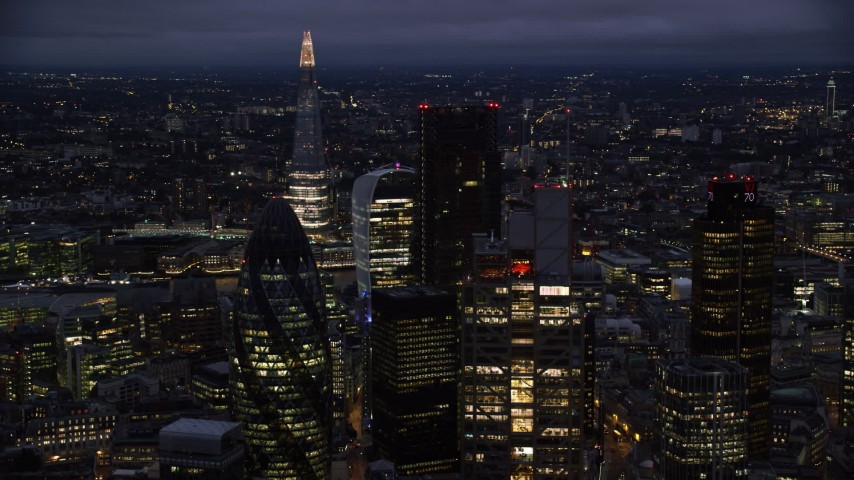 6K stock footage aerial video of flying by Central London skyscrapers, The Shard in background, England, night Aerial Stock Footage AX116_168