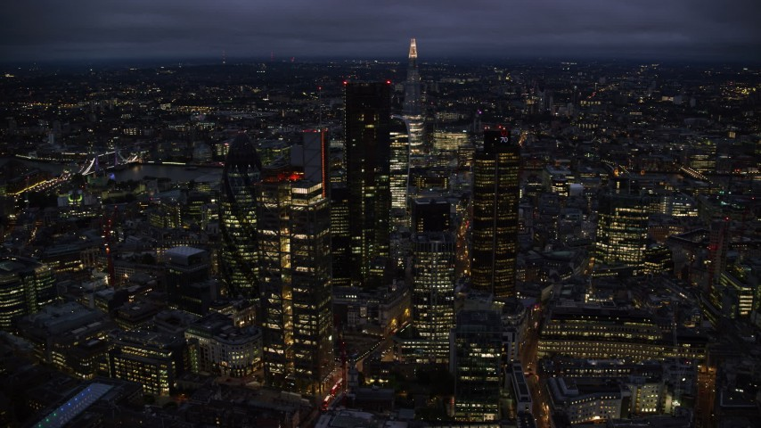 6K stock footage aerial video orbiting Central London skyscrapers with The Shard in background, England, night Aerial Stock Footage | AX116_169