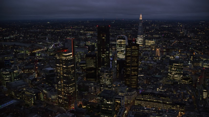 6K stock footage aerial video of passing by Central London skyscrapers, The Shard in background, England, night Aerial Stock Footage | AX116_170