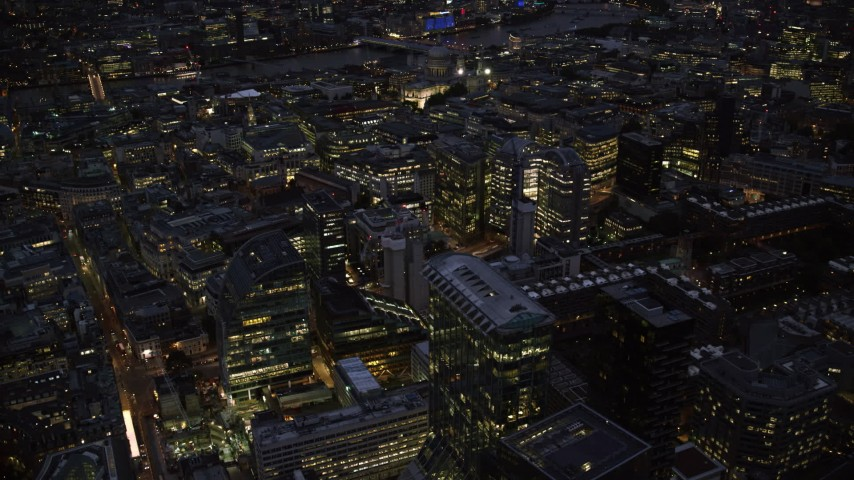 6K stock footage aerial video of flying by Central London office buildings, London, England, night Aerial Stock Footage | AX116_171