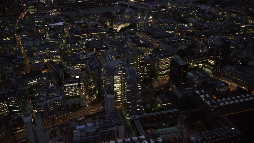 6K stock footage aerial video of panning across Central London office buildings, England, night Aerial Stock Footage | AX116_172