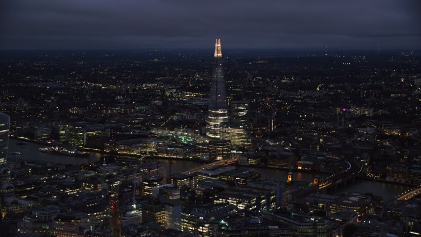6K stock footage aerial video of a view of The Shard and River Thames, London, England, night Aerial Stock Footage | AX116_173