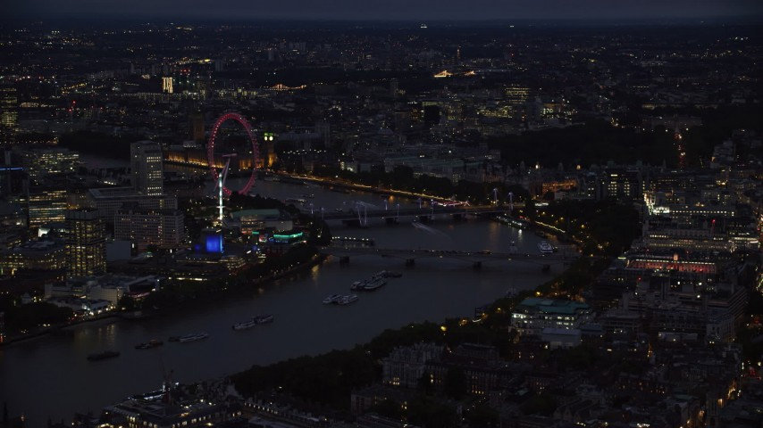 6K stock footage aerial video of approaching bridges spanning River Thames and London Eye, London, England, night Aerial Stock Footage | AX116_174