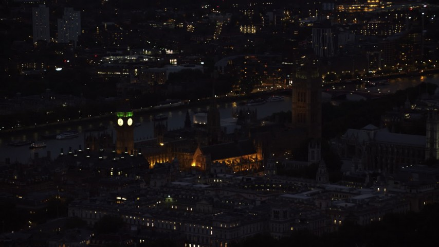 6K stock footage aerial video of flying by Big Ben and British Parliament, London, England, night Aerial Stock Footage | AX116_181