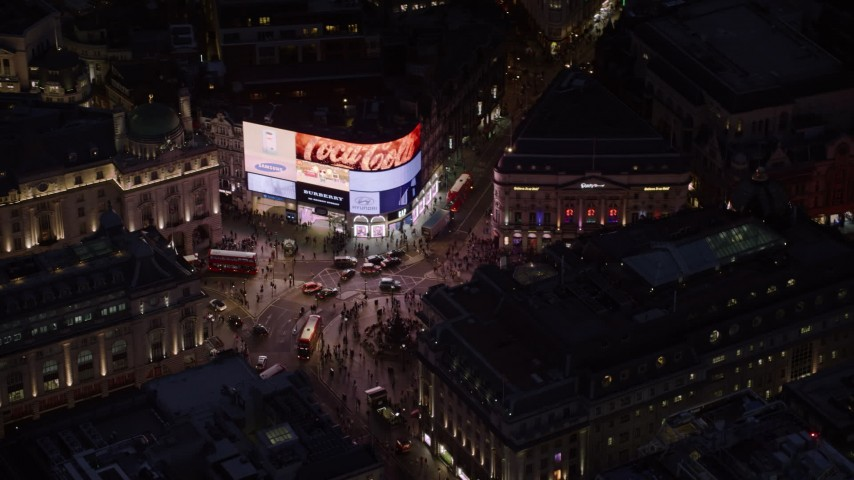 6K stock footage aerial video of orbiting crowds and buses at Piccadilly Circus, London, England, night Aerial Stock Footage AX116_185 | Axiom Images