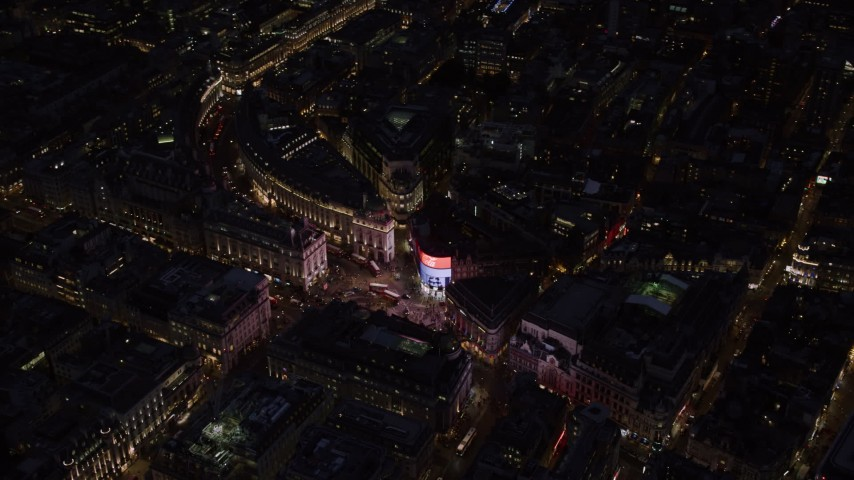 6K stock footage aerial video of circling above Piccadilly Circus and city buildings, London, England, night Aerial Stock Footage | AX116_186