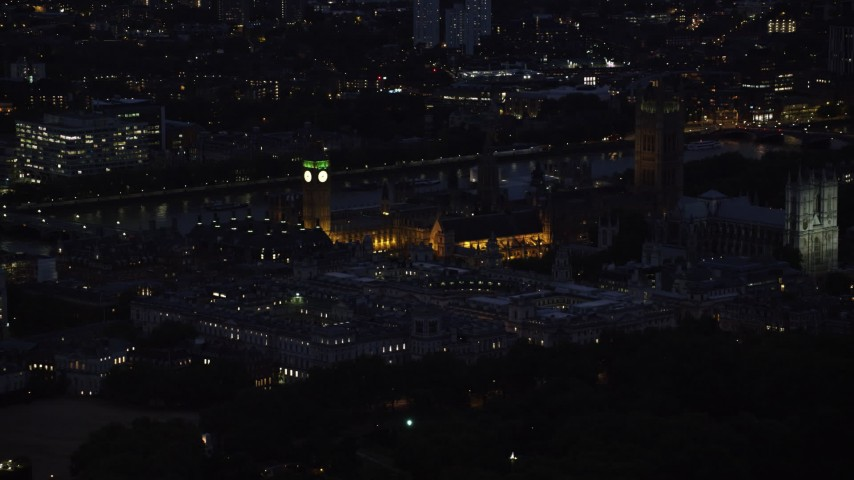 6K aerial video of flying by Big Ben, British Parliament and Westminster Abbey, London, England, night Aerial Stock Footage | AX116_189