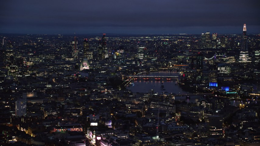 6K stock footage aerial video of flying by Central London cityscape around River Thames, London, England, night Aerial Stock Footage | AX116_190