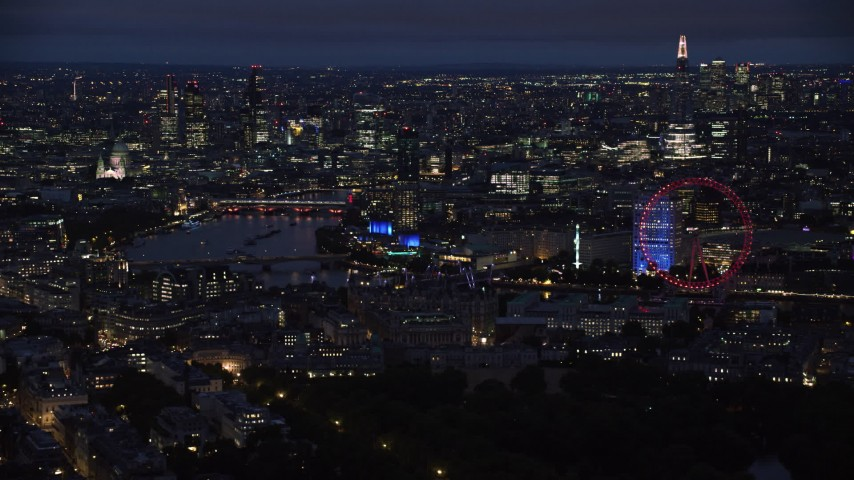 6K stock footage aerial video flyby skyscrapers and the London Eye by River Thames, London, England, night Aerial Stock Footage | AX116_192
