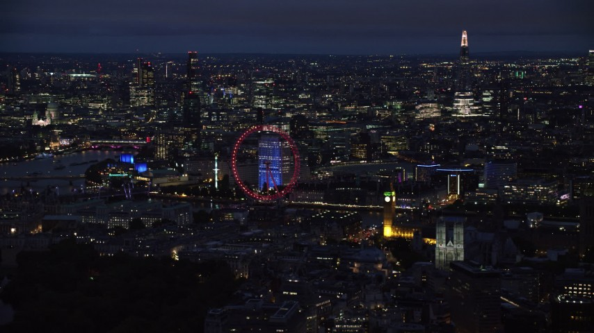 6K stock footage aerial video of London Eye, Big Ben by the River Thames, London, England, night Aerial Stock Footage | AX116_194