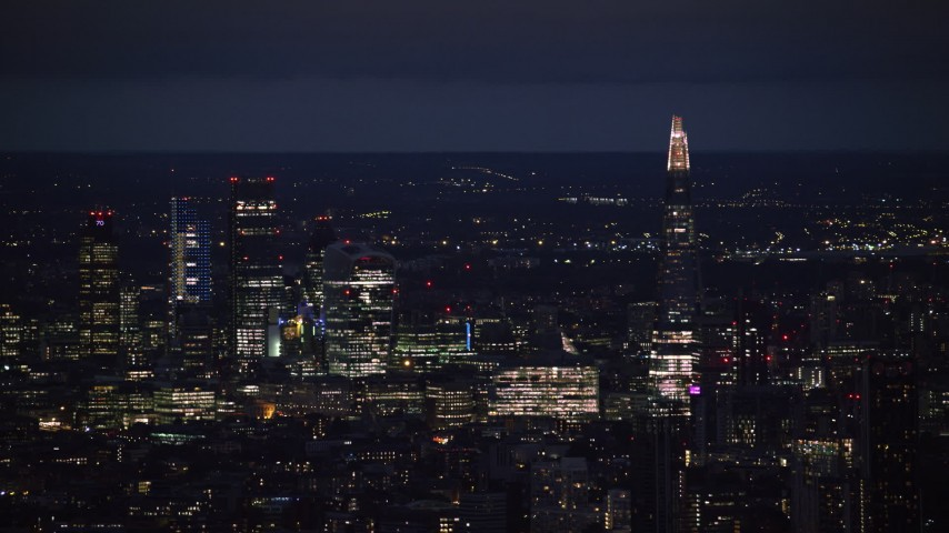 6K aerial video of a view of The Shard and skyscrapers in Central London, England, night Aerial Stock Footage | AX116_200