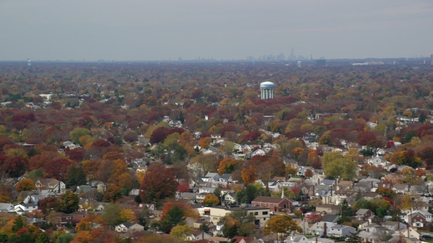 6K stock footage aerial video of a peaceful suburban residential neighborhood in Autumn, Farmingdale, New York Aerial Stock Footage | AX117_002