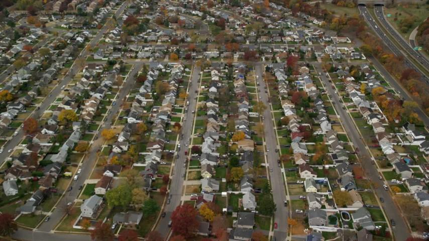 6K stock footage aerial video approach suburban neighborhood in Autumn, Wantagh, New York Aerial Stock Footage | AX117_015