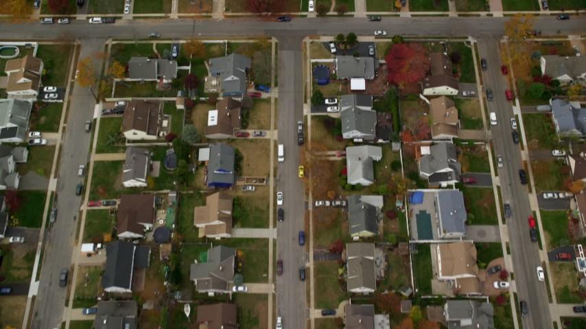 6K stock footage aerial video of a bird's eye of suburban neighborhood in Autumn, Wantagh, New York Aerial Stock Footage | AX117_016