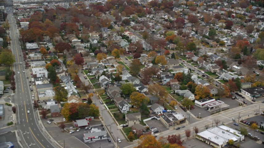 6K stock footage aerial video of an orbit over suburban neighborhoods in Autumn, Wantagh, New York Aerial Stock Footage | AX117_047