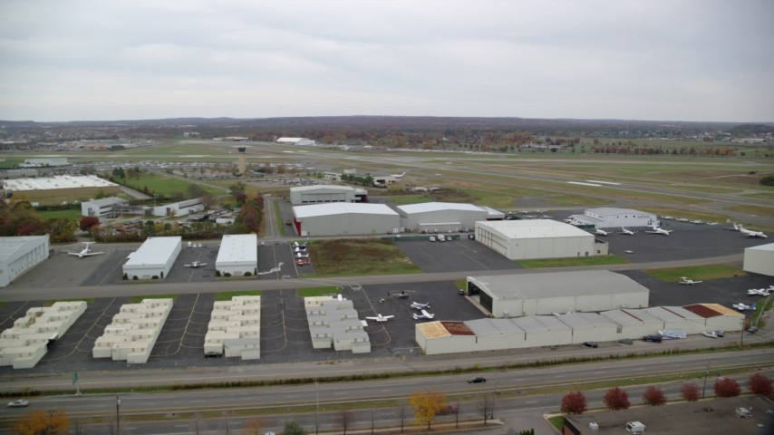6K stock footage aerial video of flying over Republic Airport in Autumn, Farmingdale, New York Aerial Stock Footage   AX117_062