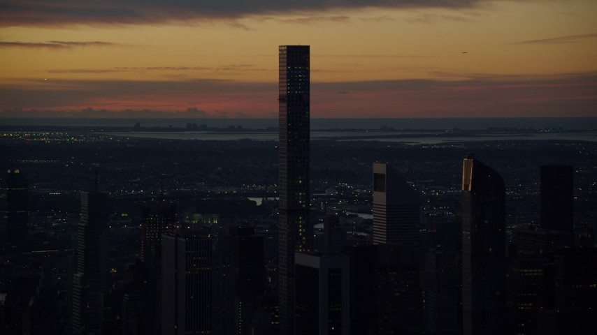 6K stock footage aerial video of 432 Park Avenue condo high-rise at sunrise in Midtown Manhattan, New York City Aerial Stock Footage | AX118_001