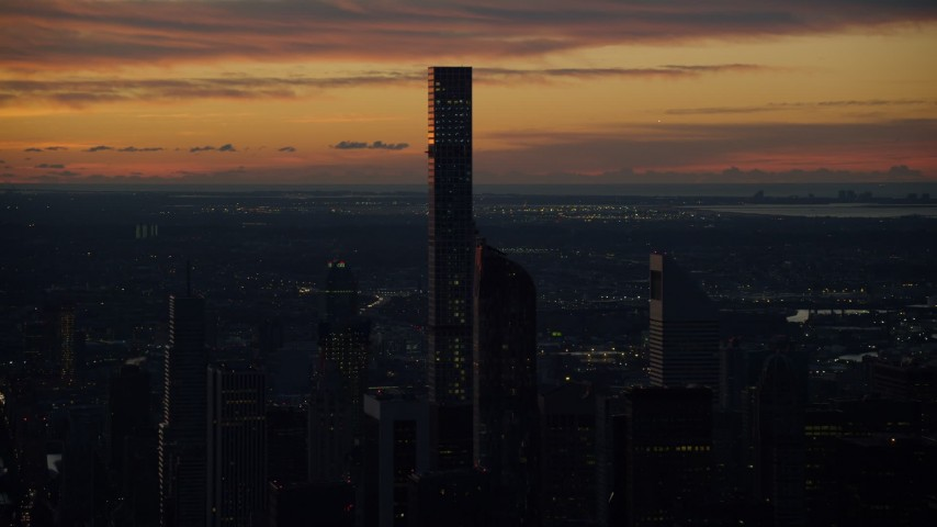 6K aerial video of an orbit of the 432 Park Avenue condo high-rise at sunrise, Midtown Manhattan, New York City Aerial Stock Footage | AX118_003