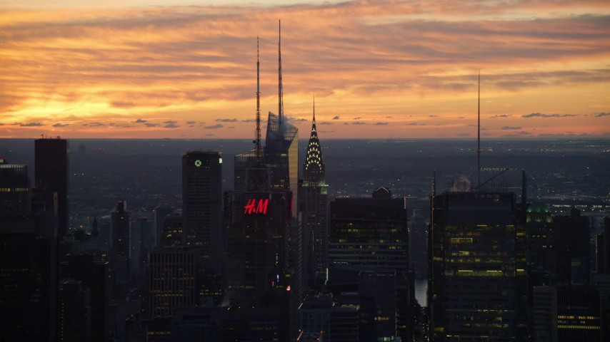 6K stock footage aerial video of Chrysler Building and skyscrapers in Midtown at sunrise, New York City Aerial Stock Footage | AX118_006
