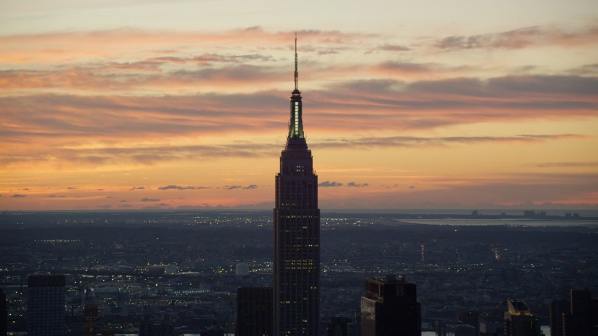 6K stock footage aerial video of the famous Empire State Building at sunrise in Midtown Manhattan, New York City Aerial Stock Footage | AX118_007