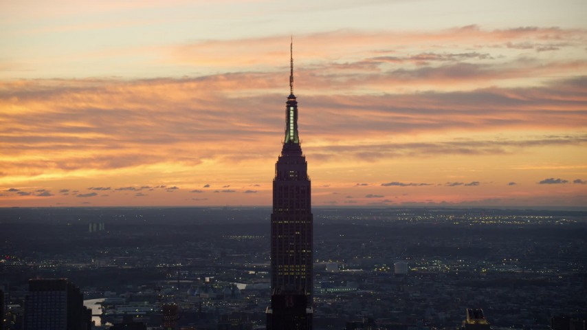 6K stock footage aerial video of an orbit of the Empire State Building at sunrise in Midtown Manhattan, New York City Aerial Stock Footage | AX118_008
