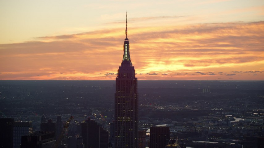 6K aerial video of the iconic Empire State Building at sunrise in Midtown Manhattan, New York City Aerial Stock Footage | AX118_009
