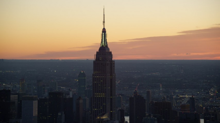6K stock footage aerial video of historic Empire State Building at sunrise in Midtown Manhattan, New York City Aerial Stock Footage | AX118_010
