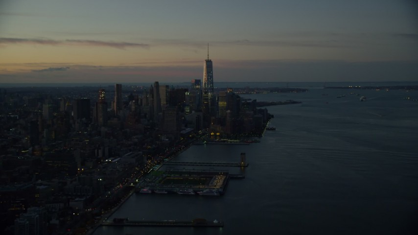6K stock footage aerial video of World Trade Center skyscrapers at sunrise in Lower Manhattan, New York City Aerial Stock Footage | AX118_011