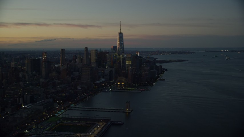 6K stock footage aerial video a view of World Trade Center at sunrise in Lower Manhattan, New York City Aerial Stock Footage | AX118_012