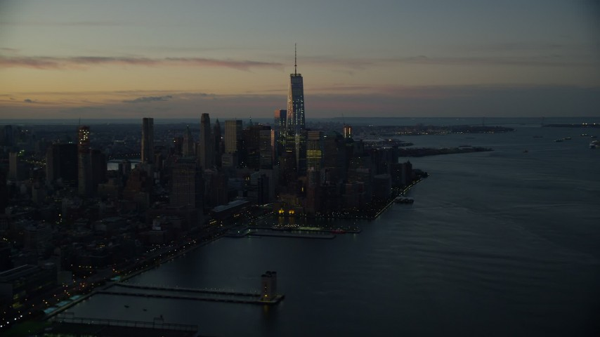 6K stock footage aerial video of tall World Trade Center skyscrapers at sunrise in Lower Manhattan, New York City Aerial Stock Footage | AX118_013