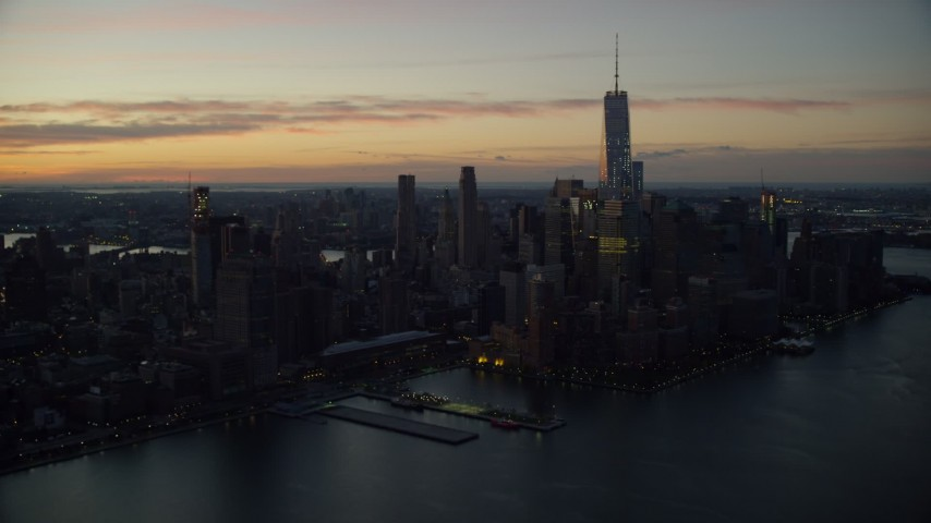 6K aerial video of Freedom Tower and World Trade Center at sunrise in Lower Manhattan, New York City Aerial Stock Footage | AX118_014
