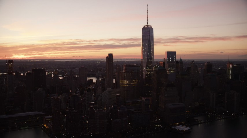 6K stock footage aerial video of World Trade Center skyscrapers at sunrise in Lower Manhattan, New York City Aerial Stock Footage | AX118_016