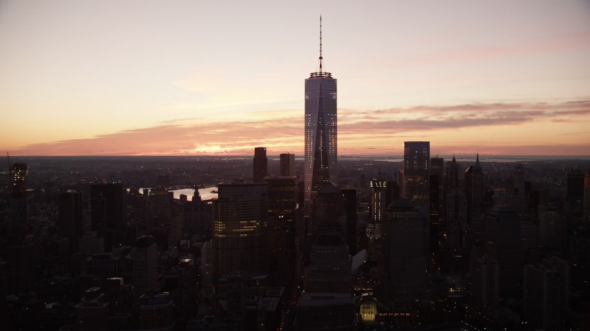6K stock footage aerial video of One World Trade Center at sunrise in Lower Manhattan, New York City Aerial Stock Footage | AX118_017